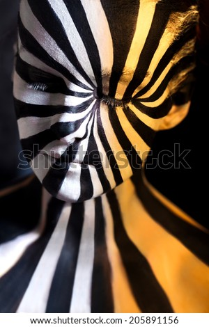 Tricolor spiral bodyart on the body of a young girl. Look like zebra pattern skin - stock photo