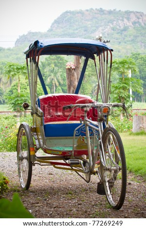 Tricycle bicycle antique - stock photo