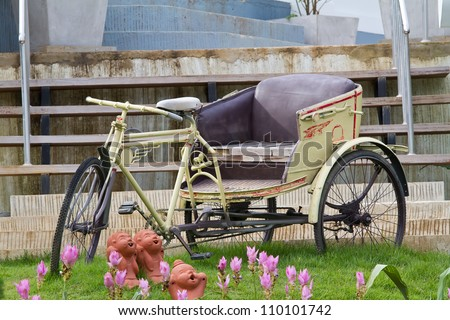 Tricycle bicycle antique in thailand - stock photo