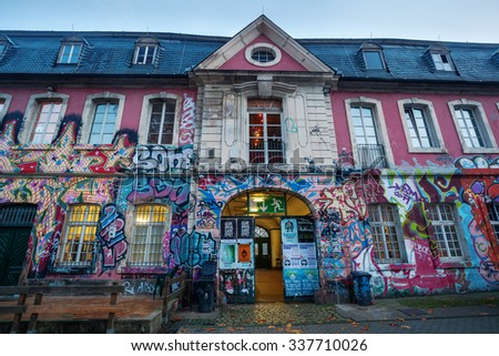 TRIER, GERMANY - NOVEMBER 05, 2015: artistic graffiti at the Exzellenz house. Its a historical building, at first part of a monastery then military baracks since 1971 a center for youth and culture.