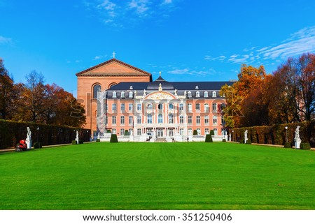 TRIER, GERMANY - NOVEMBER 05, 2015: electoral palace with unidentified people. It is a renaissance and rococo building from 17th century, where formerly the archbishop-electorals of Trier resided - stock photo