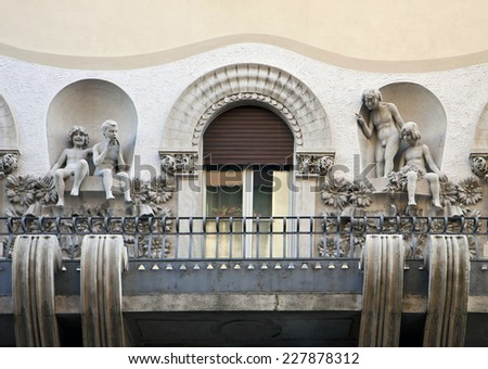 Trieste, Italy - Art nouveau balcony decorated with statues of children  in playful mode - stock photo