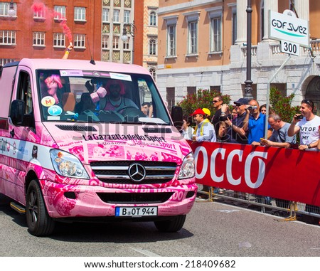 TRIESTE, ITALY -  JUNE, 01: Pink truck during the final parade of 97th edition of the Giro d'Italia on June 01, 2014 - stock photo