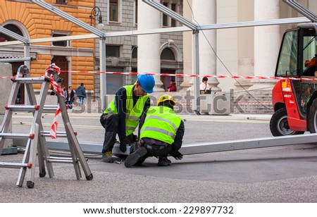 TRIESTE, ITALY - NOVEMBER, 04: Construction workers assembling a steel frame on November 04, 2014 - stock photo