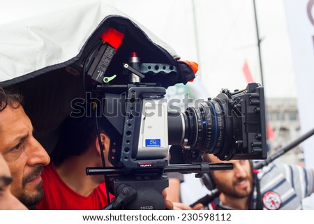 TRIESTE, ITALY - OCTOBER, 12: Cameraman in action during the production of short film on October 12, 2014 - stock photo
