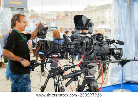 TRIESTE, ITALY - OCTOBER, 12: The crew of the RAI, Radiotelevisione italiana, preparing the interview set during the 46 th Barcolana on October 12, 2014 - stock photo