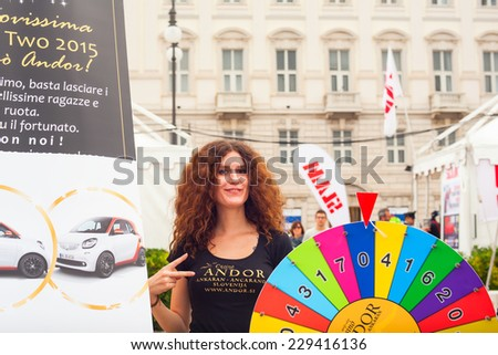 TRIESTE, ITALY - OCTOBER, 10: View of wheel of Fortune in the Trieste street during the 46th Barcolana on October 10, 2014 - stock photo