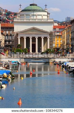 Trieste neo-classical Church of St. Antonio Thaumaturgo over The Grand Canal. Italy. - stock photo