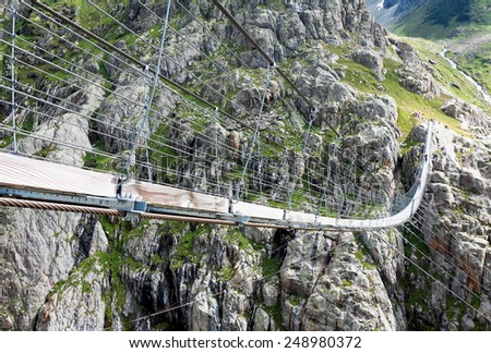 Trift Bridge, pedestrian-only suspension bridge in Alps. Canton of Berne. Svitzerland