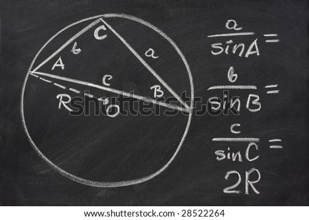 trigonometry identity - law of sines sketched with white chalk on blackboard, eraser smudges