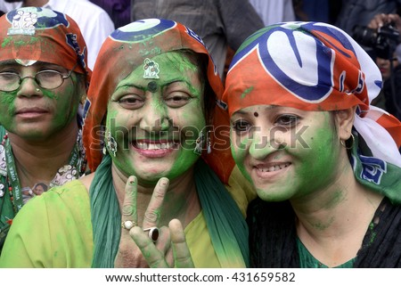 Trinamool Congress women party member shows victory sign on the occasion of T.M.C. huge win in West Bengal Legislative Election on May 19, 2016 in Calcutta, India.