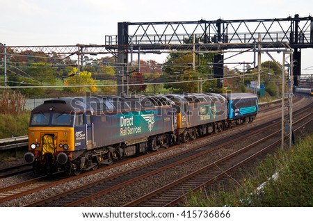TRING, UK - OCTOBER 27: A DRS empty stock movement train heads toward Crewe with just one coach in tow on October 27, 2015 in Tring.  DRS is a UK owned rail freight haulage company founded in 1995