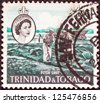 TRINIDAD AND TOBAGO - CIRCA 1960: A stamp printed in Trinidad and Tobago shows Pitch Lake and Queen Elizabeth II, circa 1960. - stock photo