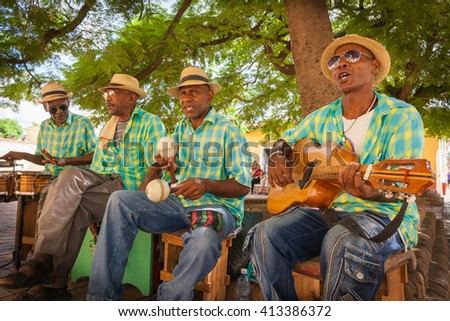 TRINIDAD, CUBA - CIRCA AUGUST 2015: Traditional Cuban musicians playing songs for tourists in Trinidad, Cuba - stock photo