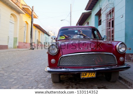 TRINIDAD, CUBA - DECEMBER 22, 2012: A classic Ford  Consul car in a street on December 22, 2012 in Trinidad, Cuba. These old and classic cars are an iconic sight of the island