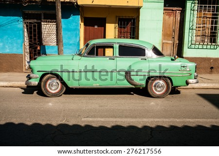 Trinidad, Cuba - 22 January, 2015: an old car parked in Trinidad historic downtown. - stock photo