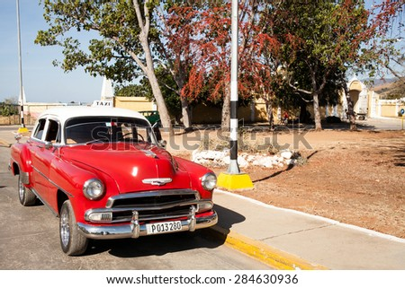Trinidad, Cuba - 22 January, 2015: an old 1953 Chevrolet, car parked in a street of Trinidad historic center.  - stock photo