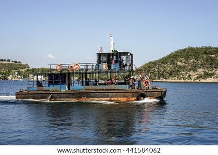 Trinidad, Cuba - January 11, 2016: Old rusty crowded ferry that sails between islands in the bay of Santiago de Cuba on the island's southern part