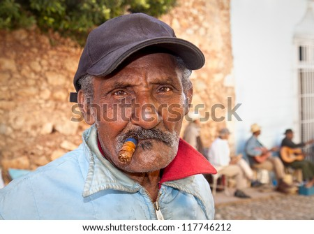 TRINIDAD,CUBA-JANUARY12:Unidentified Cuban smoking cigar on January 12. 2010.Trinidad,Cuba.Cubans of all ages are actively smoking cigars.All production in Cuba is controlled by the Cuban government. - stock photo