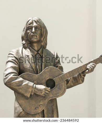 TRINIDAD,CUBA-JULY 22,2014:Statue honoring The Beatles in the Music House. The Beatles were censured in Cuba and after a rectification nowadays they are honored by the goverment - stock photo