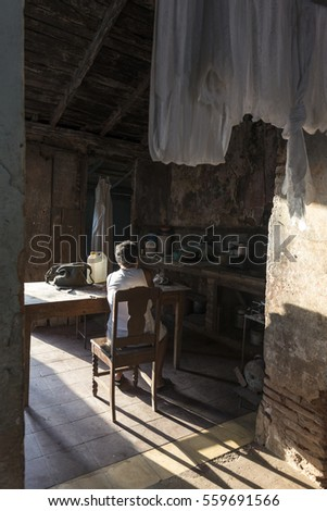 Trinidad - Cuba, March 2015: Trinidad - Cuba Match 2015; Cuban old woman and interior view of her house