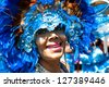 TRINIDAD WEST INDIES - FEB 5, 2008: smiling female masquerader with headdress taking part in Carnival Tuesday celebrations on February 5, 2008 in Port Of Spain, Trinidad W.I. - stock photo