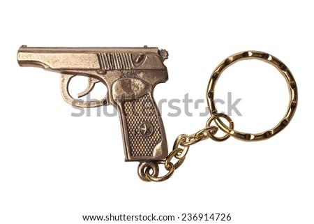 Trinket for the keys as a TT pistol isolated on white background - stock photo