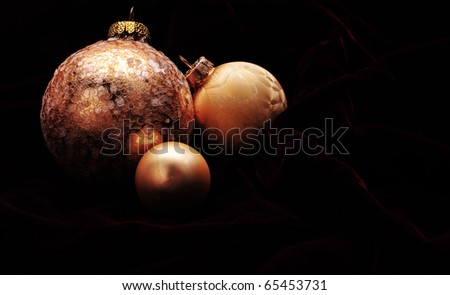 Trio of beautiful gold ornaments - stock photo