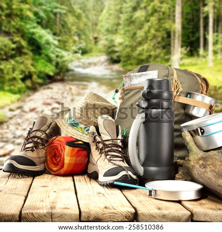 trip time and equipment on table  - stock photo