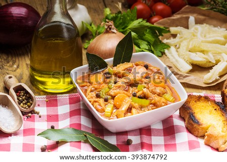 Tripe Florentine, typical Italian, Polish, French food. On a rustic table. - stock photo
