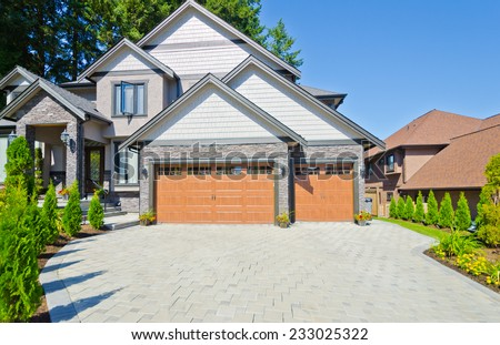 Triple doors garage and wide driveway. North America. Vancouver.