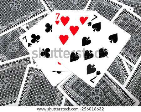 Triple 7 playing cards - stock photo