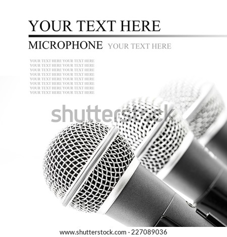Triple silver microphone isolated on white background - stock photo