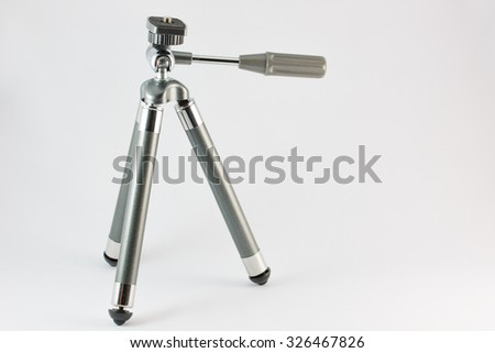 Tripod stand on the white background. - stock photo