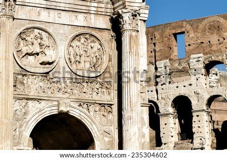 Triumphal Arch and Colosseum in Roma - stock photo