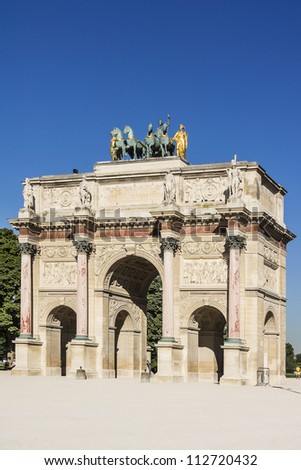 Triumphal Arch (Arc de Triomphe du Carrousel) at Tuileries gardens in Paris, France. Monument was built between 1806-1808 to commemorate Napoleon's military victories. - stock photo
