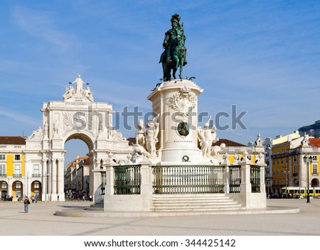Triumphal arch at Rua Augusta and bronze statue of King Jose I at Commerce square in Lisbon, Portugal. After the great 1775 Lisbon earthquake earthquake the square was completely remodeled. - stock photo