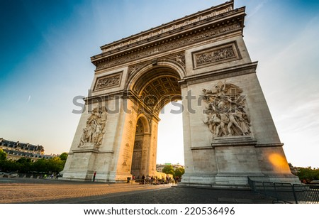 Triumphal Arch at the end of Champs-Elysees street before sunset in Paris,France - stock photo
