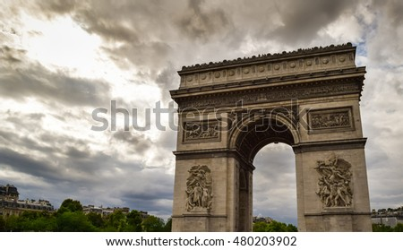Triumphal arch in Paris city at sunset. Arc de Triomphe in Paris, France. Famous Paris view on triumphal arch