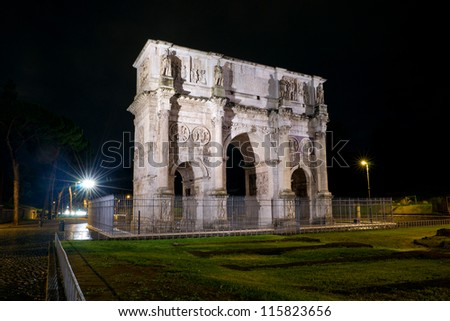Triumphal Arch of Constantine at night in Rome - stock photo