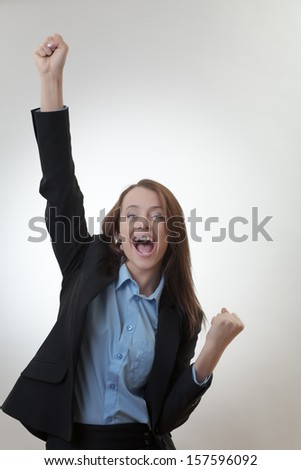 Triumphant and Happy business woman celebrating success  - stock photo