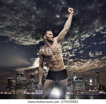 Triumphant athletic businessman - stock photo