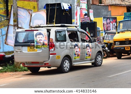 TRIVANDRUM, KERALA, INDIA, APRIL 30, 2016: An Innova (Toyota) car used in the election campaign. Posters of a BJP candidate are stuck on the car.