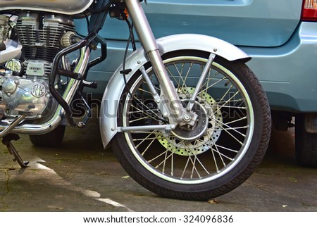 TRIVANDRUM, KERALA, INDIA, AUGUST 29, 2015: Royal enfield motor cycle. Front wheel and shock absorber.