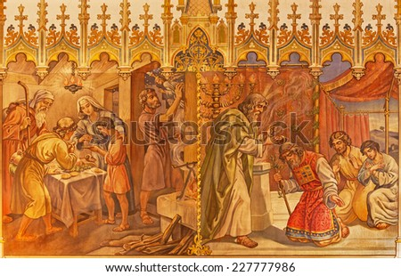 TRNAVA, SLOVAKIA - OCTOBER 14, 2014: The fresco of the scenes Moses and Aron, and Israelites at the Pesach supper at the Lord's Passover by Leopold Bruckner (1905 - 1906) in St. Nicholas church.  - stock photo