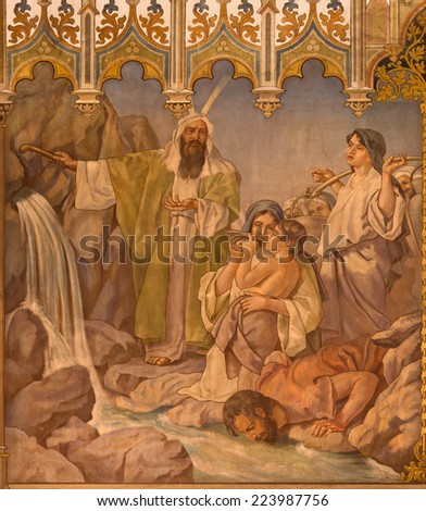 TRNAVA, SLOVAKIA - OCTOBER 14, 2014: The neo-gothic fresco of fhe scene as Moses gets water from the rock by Leopold Bruckner (1905 - 1906) in Saint Nicholas church. - stock photo