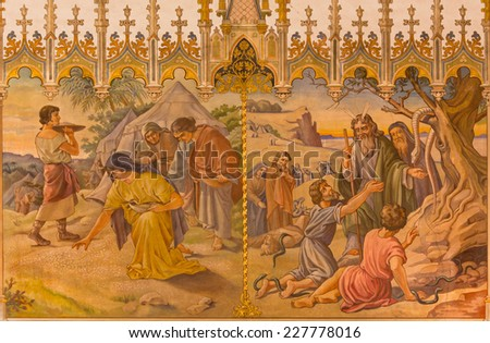 TRNAVA, SLOVAKIA - OCTOBER 14, 2014: The neo-gothic fresco of scene as Israelites at gathering of manna, and as Moses made a bronze snake by Leopold Bruckner (1905 - 1906) in Saint Nicholas church.  - stock photo