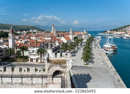TROGIR, CROATIA - JUNE, 2010: Center of the old town, the promenade on the background of sea and mountains