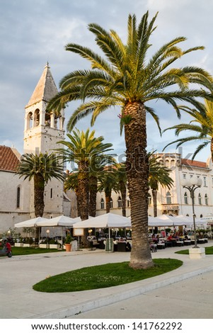 TROGIR, CROATIA - MAY 10: Tourists visit Old Town on May 10, 2013 in Trogir, Croatia. Trogir, as a UNESCO World Heritage Site, is one of most visited places in Croatia.