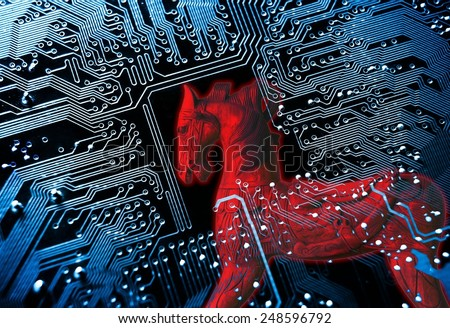 Trojan horse / symbol of a red trojan horse on blue computer circuit board background  - stock photo